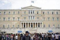 Zona euro se pregateste pentru intrarea Greciei in incapacitate de plata. Grecii isi scot in masa banii din bancomate