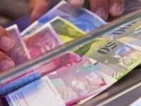 Legea conversiei creditelor in franci elvetieni, adoptata de Camera Deputatilor in unanimitate